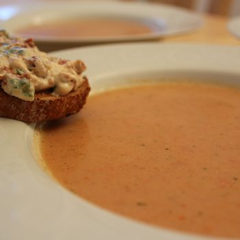 Cold tomato soup with dried tomato and spring onion crostini