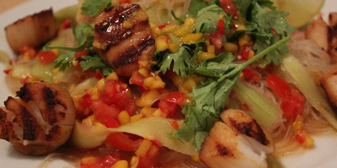 Asian rice noodles salad with scallops