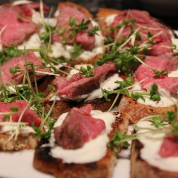 Rump of beef crostini with cress sprouts and wasabi cream