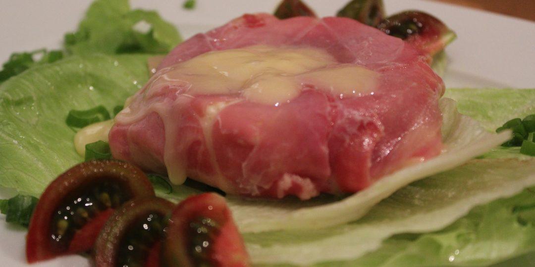 Tomino with prosciutto