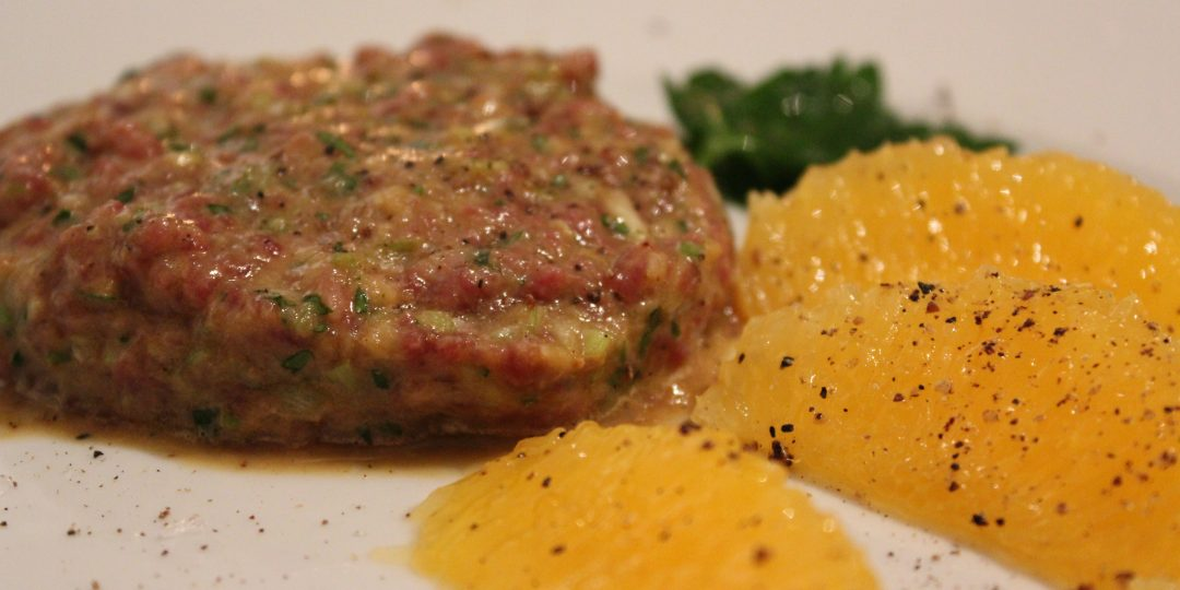 Tartare of beef with orange and leek