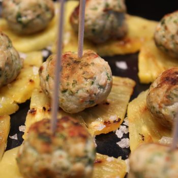 Asian chicken meatballs on grilled ananas
