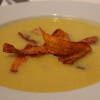 Mais cream soup with fried carrot ribbons
