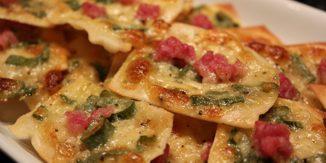 Bread chips with cheese, spring onion and bacon