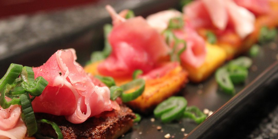 Polenta croutons with prosciutto