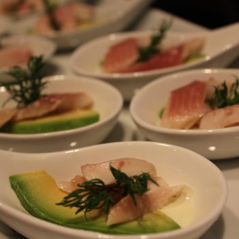 Spoons with smoked trout, avocado and wasabi sauce