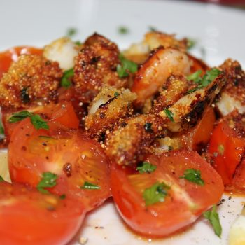Corn coated squids with grilled tomatoes salad