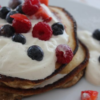 Pancakes with vanilla whipped cream and berries
