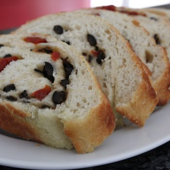 Rolled focaccia with black olives and sundried tomatoes