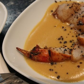 Sauteed shrimp tail with cointreau and orange juice sauce