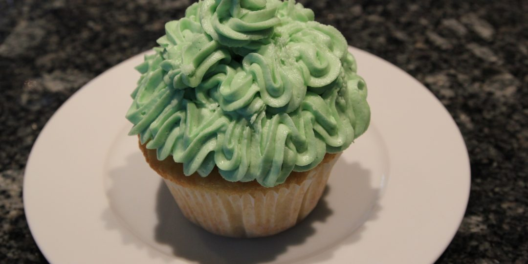 Coconut muffin with lime icing