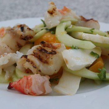 Salad of grilled shrimp, coconut, mango and cucumber