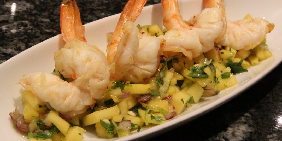 Mango and papaya salad with sesame oil shrimps