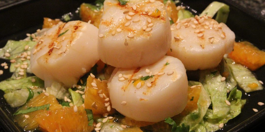 Scallop on iceberg and orange salad