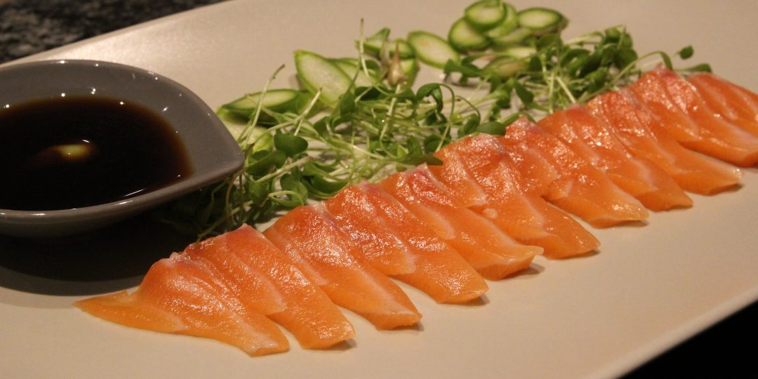 Salmon sushi with asparagus and cress sprouts salad