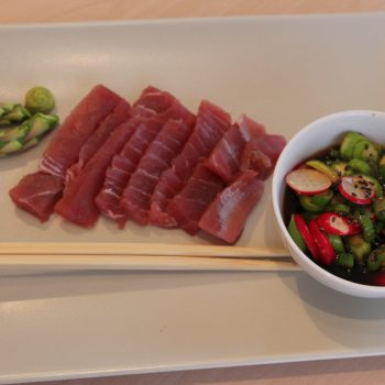 Tuna sushi with red radish and fresh asparagus salad