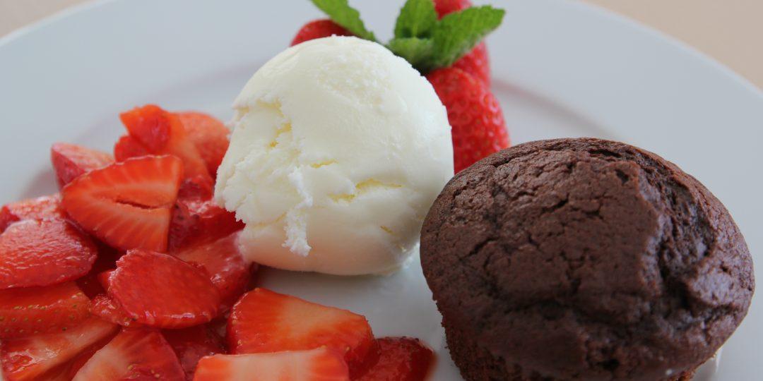 Frozen yogurt with chocolate muffin and strawberry salad