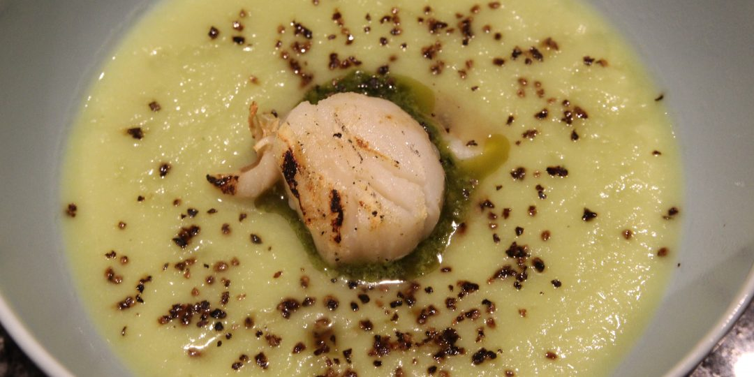 Romanesco broccoli cream soup with grilled scallop and wild garlic pesto
