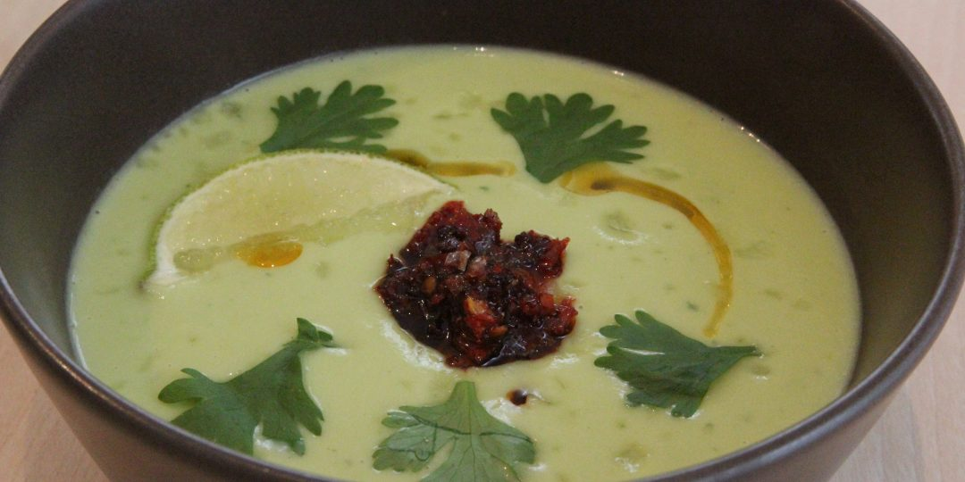 Avocado cream soup with tomatoes and chilli confit