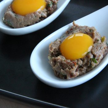 Tartare spoon with quail egg