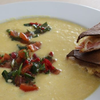 Corn cream soup and tomato salsa with cumin