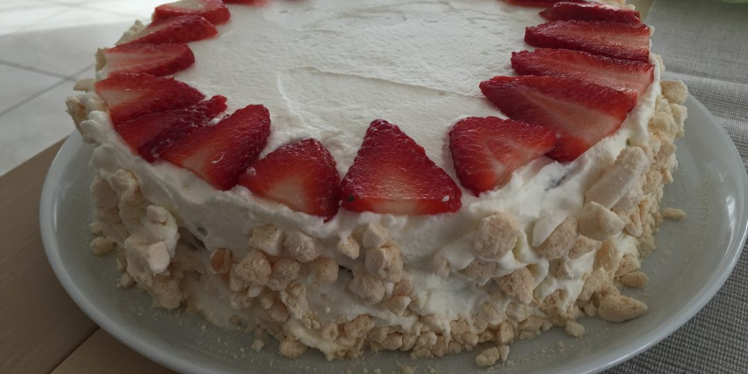 Strawberry yogurt cake with whipped cream and meringues